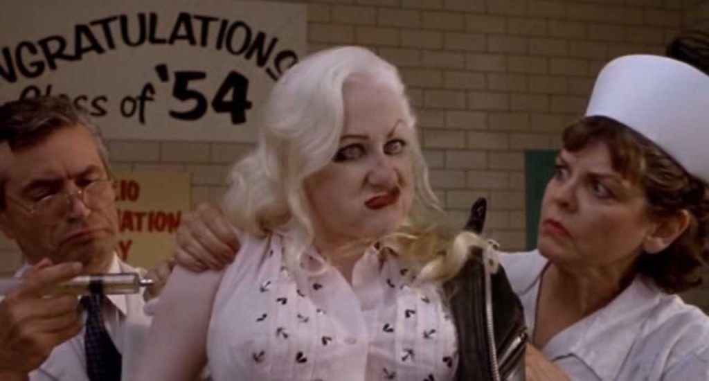 Screenshot from Cry-Baby, in which the homely Hatchetface gets an immunization shot.