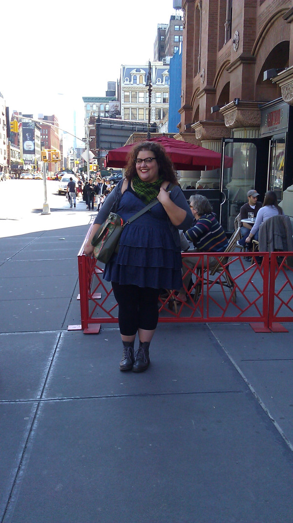 Me, standing on a New York street, wearing a ruffled chambray dress and black leggings and grey boots.