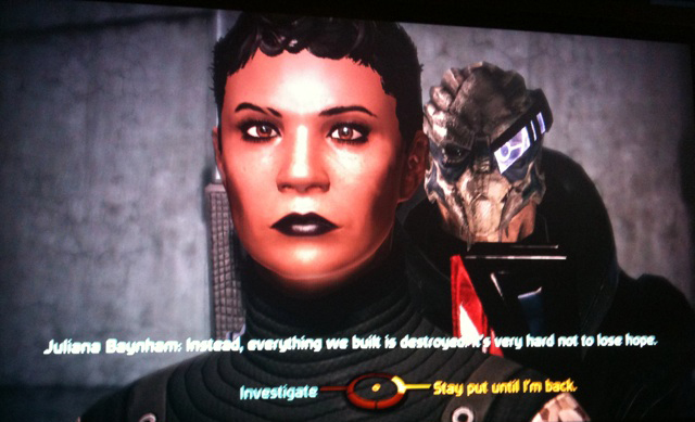 A screencap from the video game Mass Effect, showing a brown-skinned woman with short dark hair, my version of Commander Shepard.