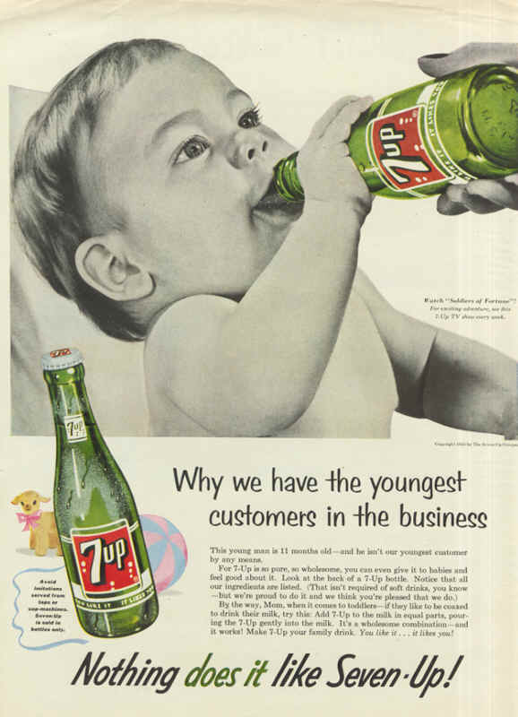 Vintage 7UP advertisement (1960s?) showing a baby drinking from a bottle of 7UP. Because it's WHOLESOME.